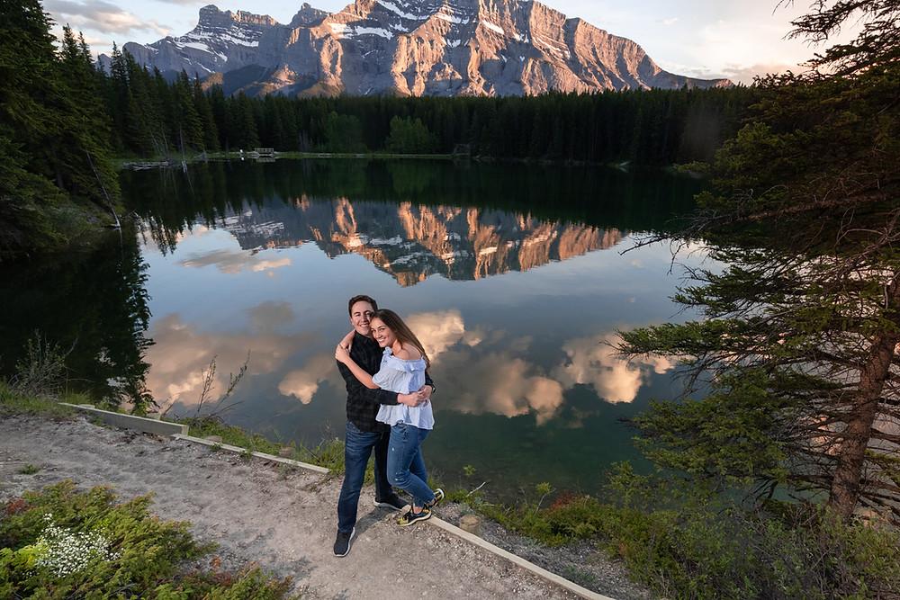 Couple at Banff Johnson Lake with Rundle Mountain reflecting