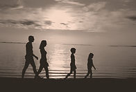 family walking on the beach of Bali