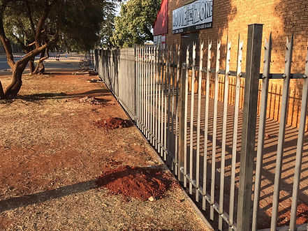 Palisade fencing section completed