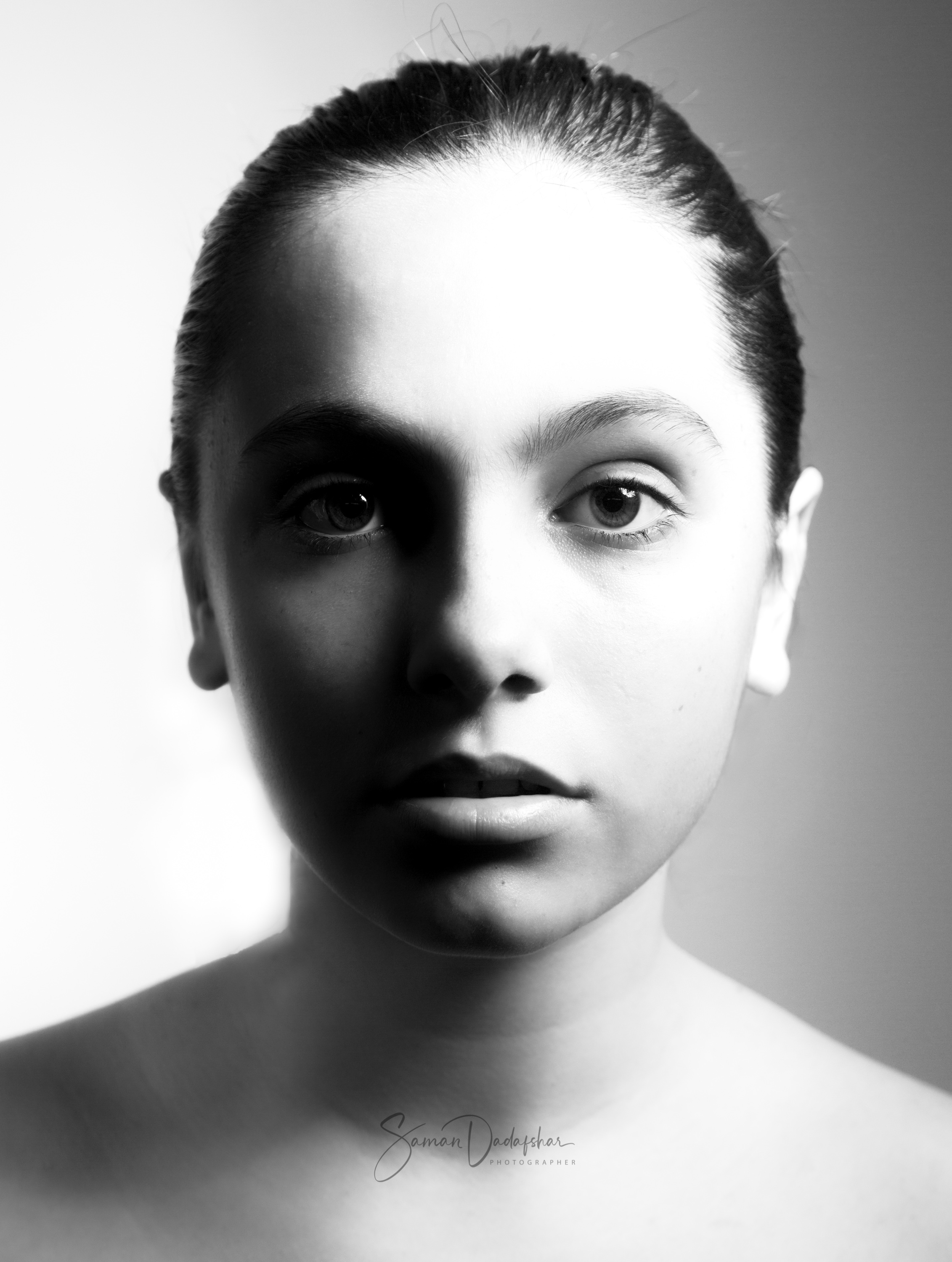 Black and White portrait of female model with split lighting