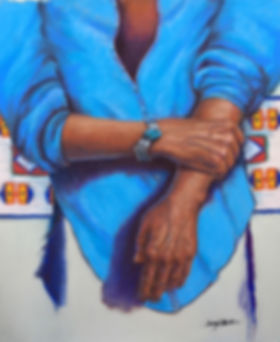Honoring my Elders - image of a transgender Native American wearing the bracelet of their ancestors. A Cheyenne bead pattern display is in the background. The person  is wearing a sky blue shirt with large sleeves.