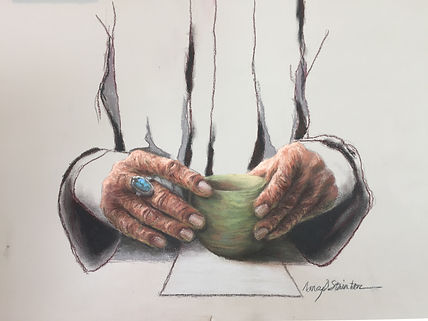 Tea Time - image of hands drinking tea in Japanese Tea ceremony style. The person is wearing a turquoise and silver ring. The tea cup is an earthenware green color.