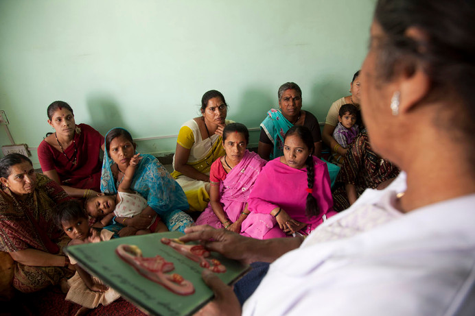Beneficiaries receive counselling on family planning methods at the Family Planning Association of India (FPAI) Satellite Clinic in the Bagh Mughalia locality of Bhopal, Madhya Pradesh, India, 2012.