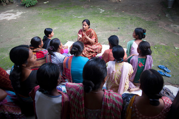 FPAI Counsellor, Chhanda Dutta Chakravarty conducts a Focus Group Discussion (FGD) with village women, beneficiaries of of Family Planning Association of India's (FPAI) Kalchini branch, at Nimati Rava Forest Busti, Kalchini, West Bengal, India, 2012.