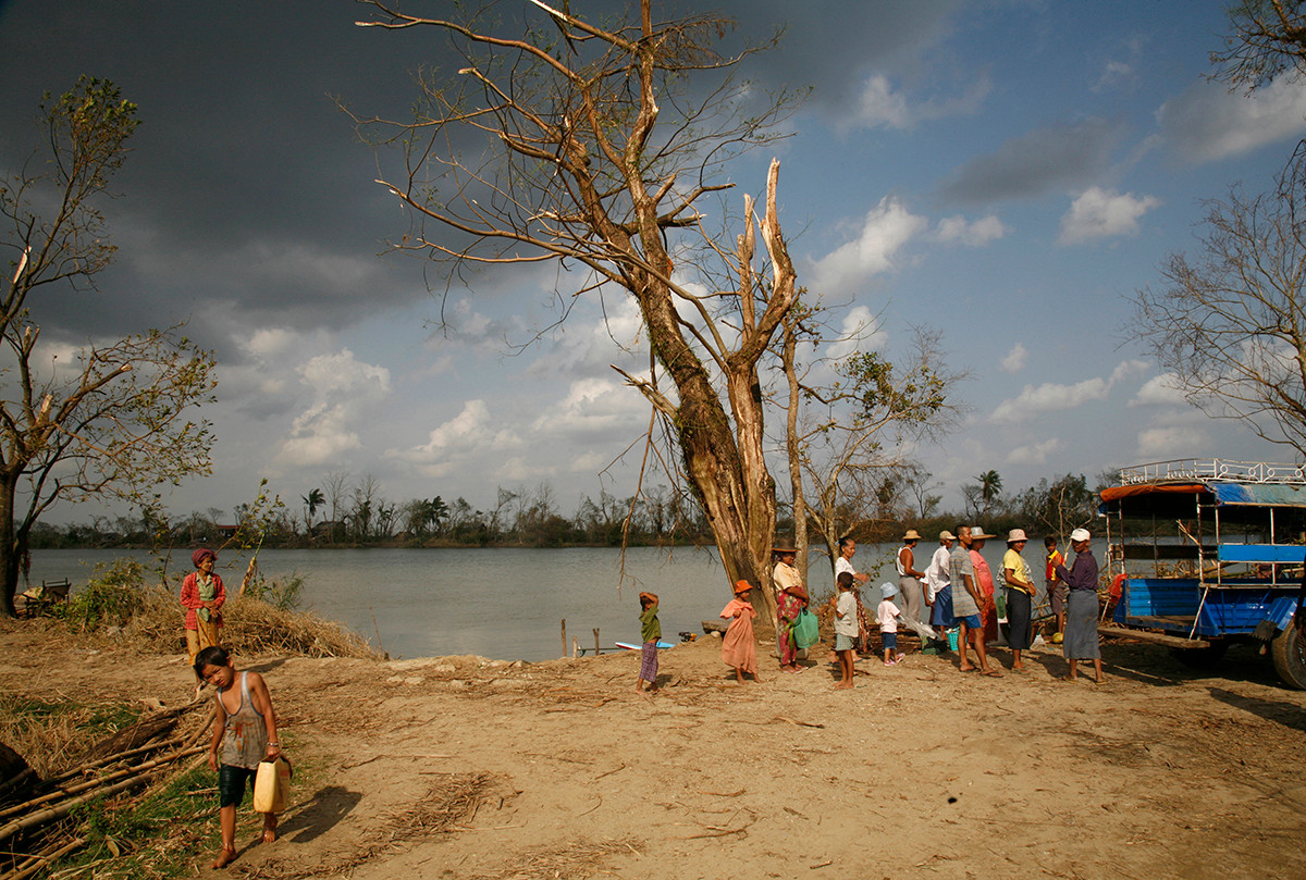 People wait to cross the river at the Thar Yar Wae village affected by Cyclone Nargis, on the road to Bogalay, in the Irrawaddy Division of Myanmar (Burma).