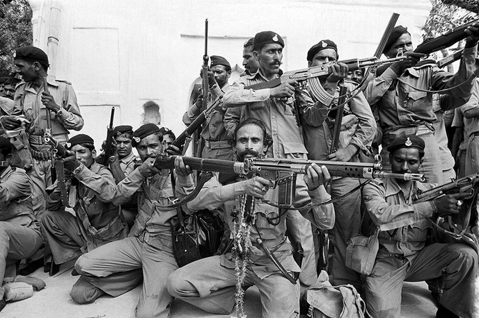 Malkhan Singh and his gang in his village, Bilao, on the day of his surrender, 1982