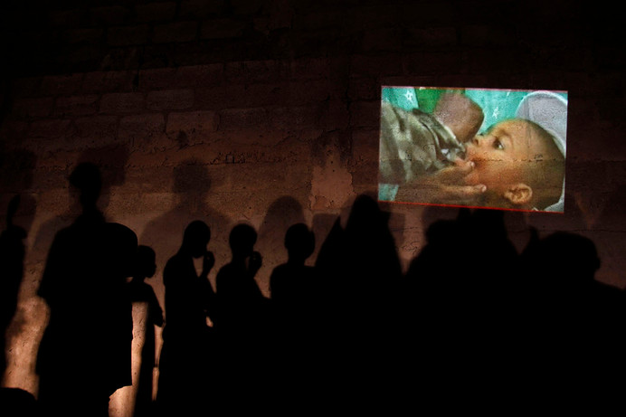 Residents watch a Majigi film show about polio in Kano, Nigeria, 2010.
