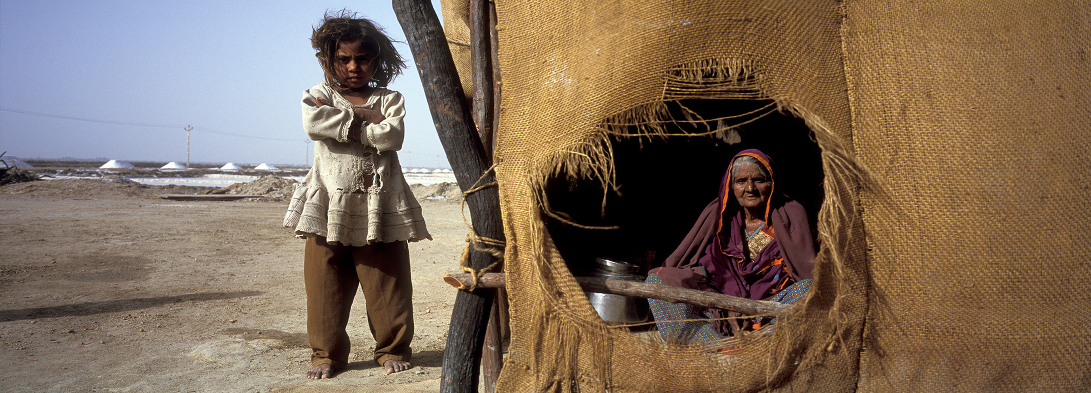 Anjar, Gujarat, 2005: A migrant worker's family working in salt-ans at their dwelling at the work site.