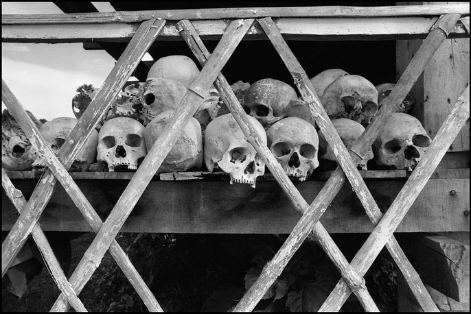 Skulls of victims of the Khmer Rouge's genocide displayed at the Choeung Ek mass grave.