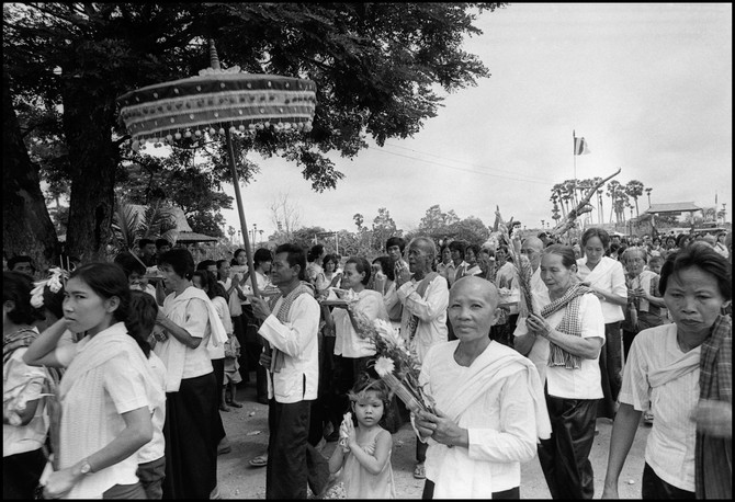 Devotees walk to a pagoda during a Buddhist ceremony.