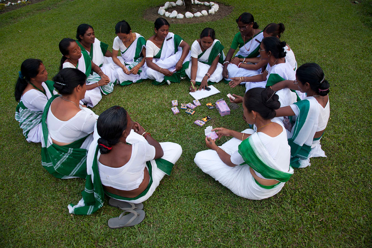 Members of the Chuapara Mothers' Club, inked with Family Planning Association of India's (FPAI) Kalchini branch, hold a meeting in the Chuapara Tea Estate hospital grounds, Kalchini, West Bengal, 2012.