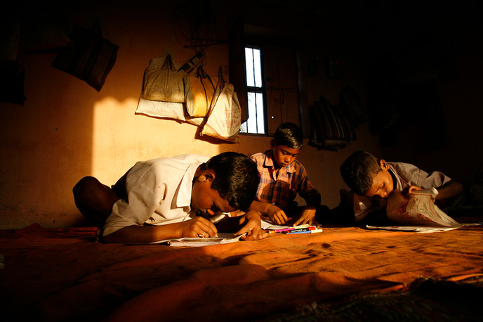 Bolangir, Orissa, 2006: Resident students of seasonal migrant workers do their homework at AIF supported Seasonal Hostel at Sonmudi.
