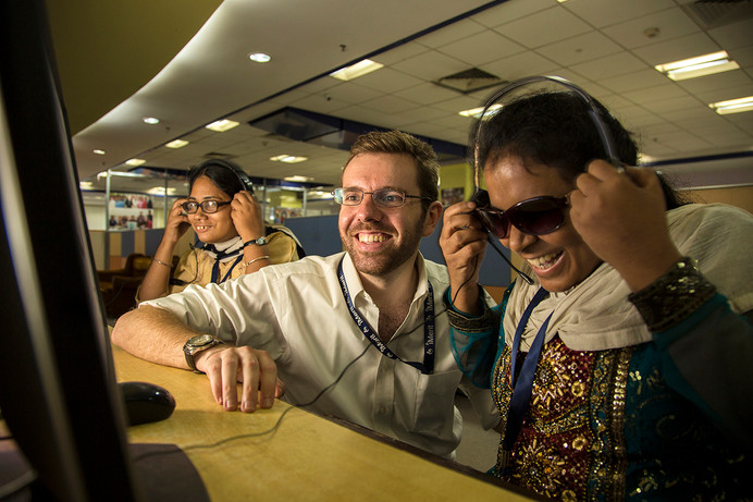 AIF Fellow, John Simpson, with visually impaired employees at I-Merit Salt Lake City centre in Kolkata, West Bengal, India, 2016.