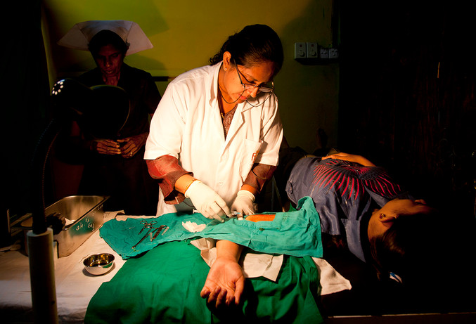 A beneficiary receives a Jadelle at FPA Sri Lanka's Suwa Sewa Centre at Mardana, Colombo, Sri Lanka, 2012.