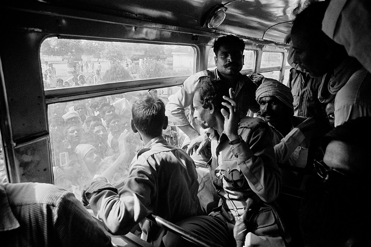 Malkhan Singh and his gang travel in a bus to the Gwalior Central jail after the surrender ceremony at Bhind, 1982.