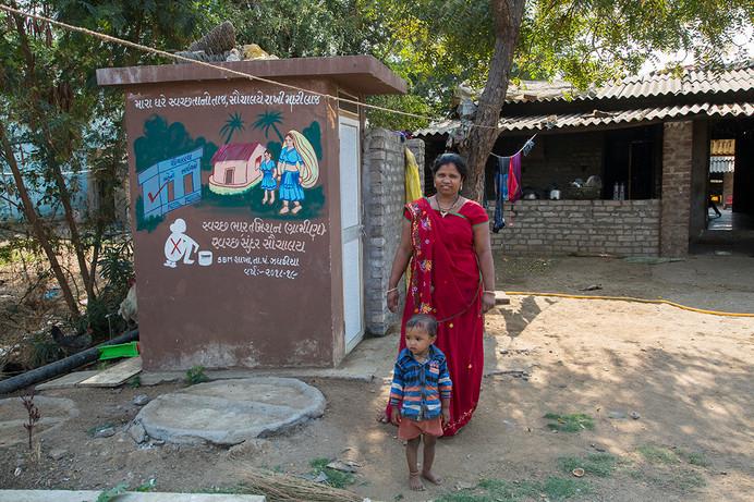 Sonal who has built an extension to her toilet constructed under Kohler Stewardship program at Randedi village near Kohler's plants in Jhagadia, Gujarat, India, 2019.