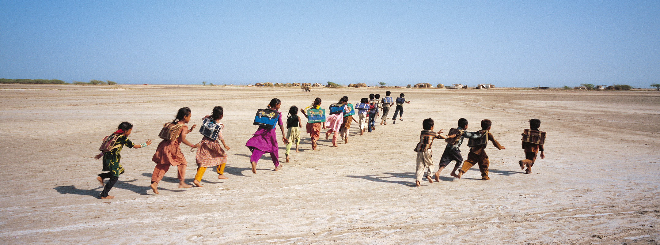 Kutch, Gujarat, 2006: Children return from an AIF supported site school for the migrant Muslim Machhimaar community at Luni Bunder.