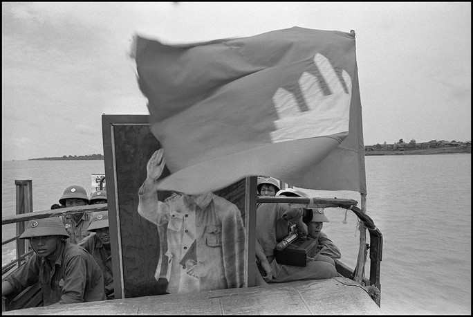 Returning Vietnamese soldiers cross the Mekong river during the first troop withdrawals.