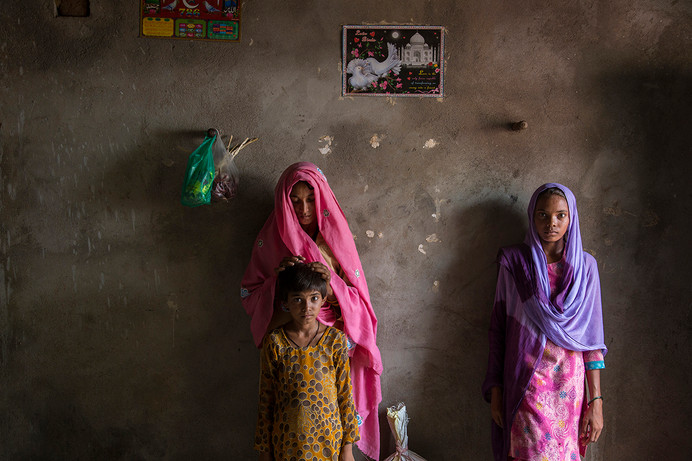 PLHIV beneficiaries of Vihaan Care & Support, Maksoodi and her daughters, at their home in Motibas village, Alwar district, Rajasthan, India, 2014.