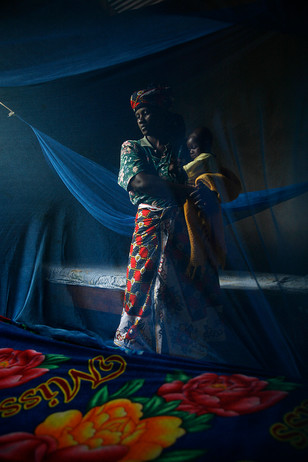 Saumo Mpotwile and her daughter, Anali, with their bed-nets at their home in Lupiro village, Ifakara, Tanzania, 2007.