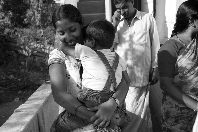 HIV+ Ashvini with her HIV+ son, Nithin (name changed) and her parents at her home in Mysore, 2008. Ashvini is an outreach worker for an NGO working on HIV-AIDS issues.