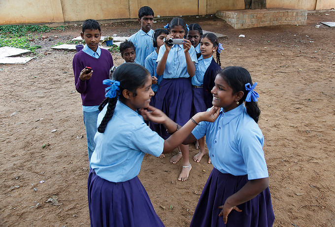 Students shoot video and take photographs with a digital camera under AIF's Digital Equaliser program at the Government Higher Primary School, Munenkolala, Bangalore, India, 2010.