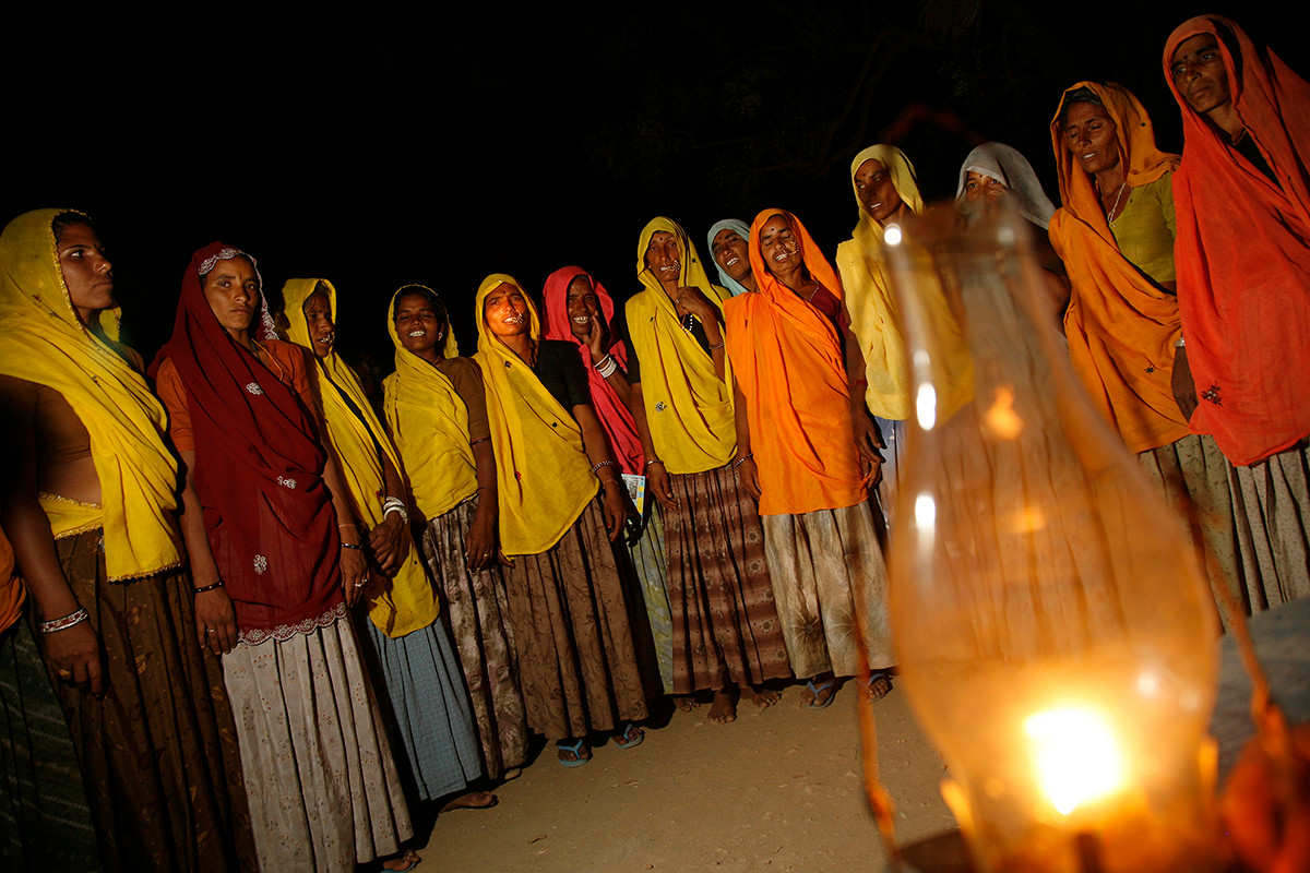 Members of SRIJAN promoted SHG, Shankar Mahila Bachat Sangh, sing songs at the end of a meeting in Nayagaon Gothra village, Tonk district, Rajasthan, India, 2007.