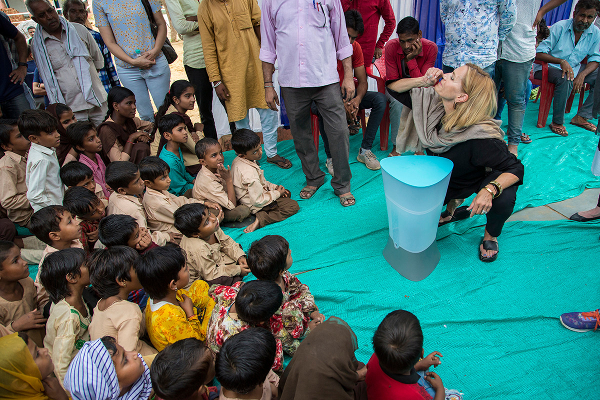 Laura Kohler demonstrates the use of  water filters being gifted to the Government Middle School at Khori village in Alwar district, Rajasthan, India under Kohler Stewardship's School Sanitation Project, 2018.