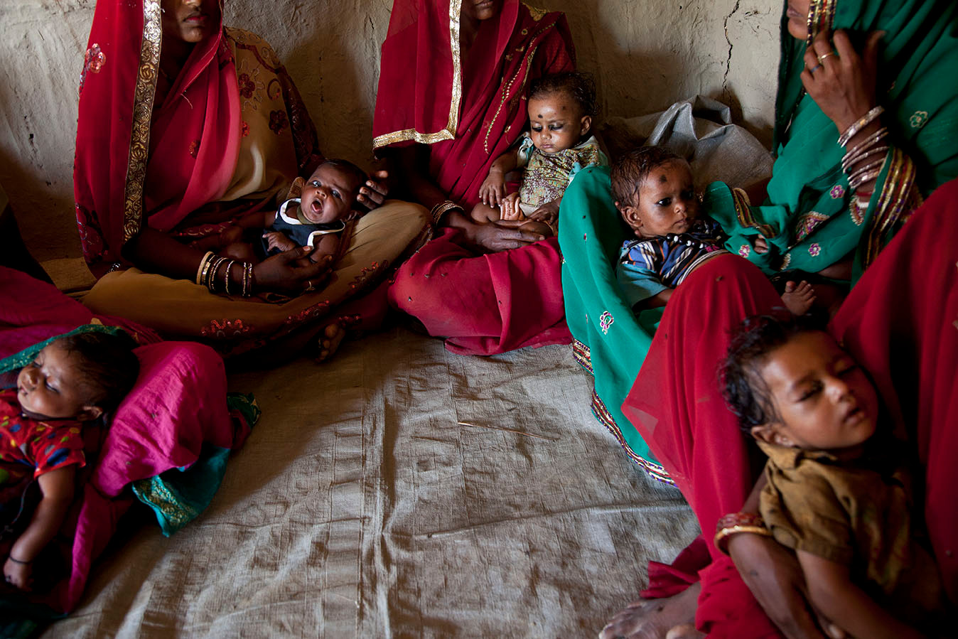 Beneficiaries wait at the Anganwadi Centre for routine immunization in Roti Mushahari village, Saharsa district, Bihar, India, 2013.