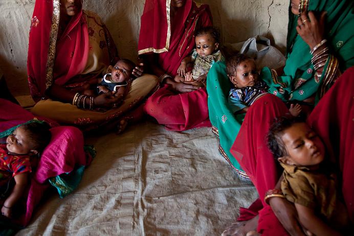 Beneficiaries wait at the Anganwadi Centre for routine immunization in Roti Mushahari village, Saharsa district, Bihar, India, 2013.