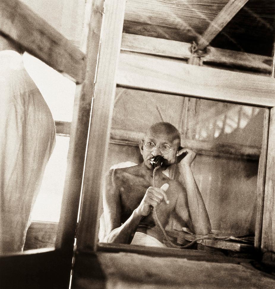 Sevagram Ashram, 1938: Mahatma Gandhi telephoning from the office hut.