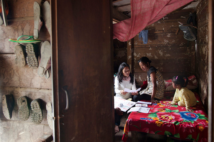 Family Planning Association of India (FPAI) Outreach worker visits HIV+ Phamlong Konyak at her home for counselling work in Kohima, Nagaland, India, 2012.