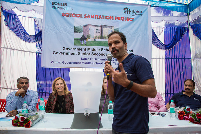 A Kohler techician explains the working of a water filters being gifted to the Government Middle School at Khori village in Alwar district, Rajasthan, India under Kohler Stewardship's School Sanitation Project, 2018.