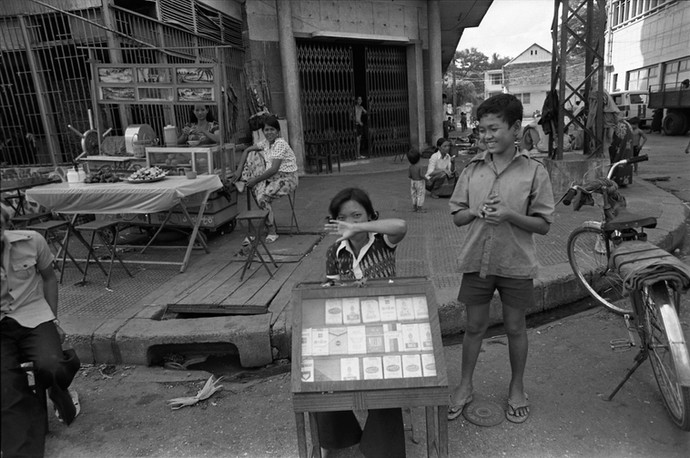Cigarette seller at a street corner in Phnom Penh.