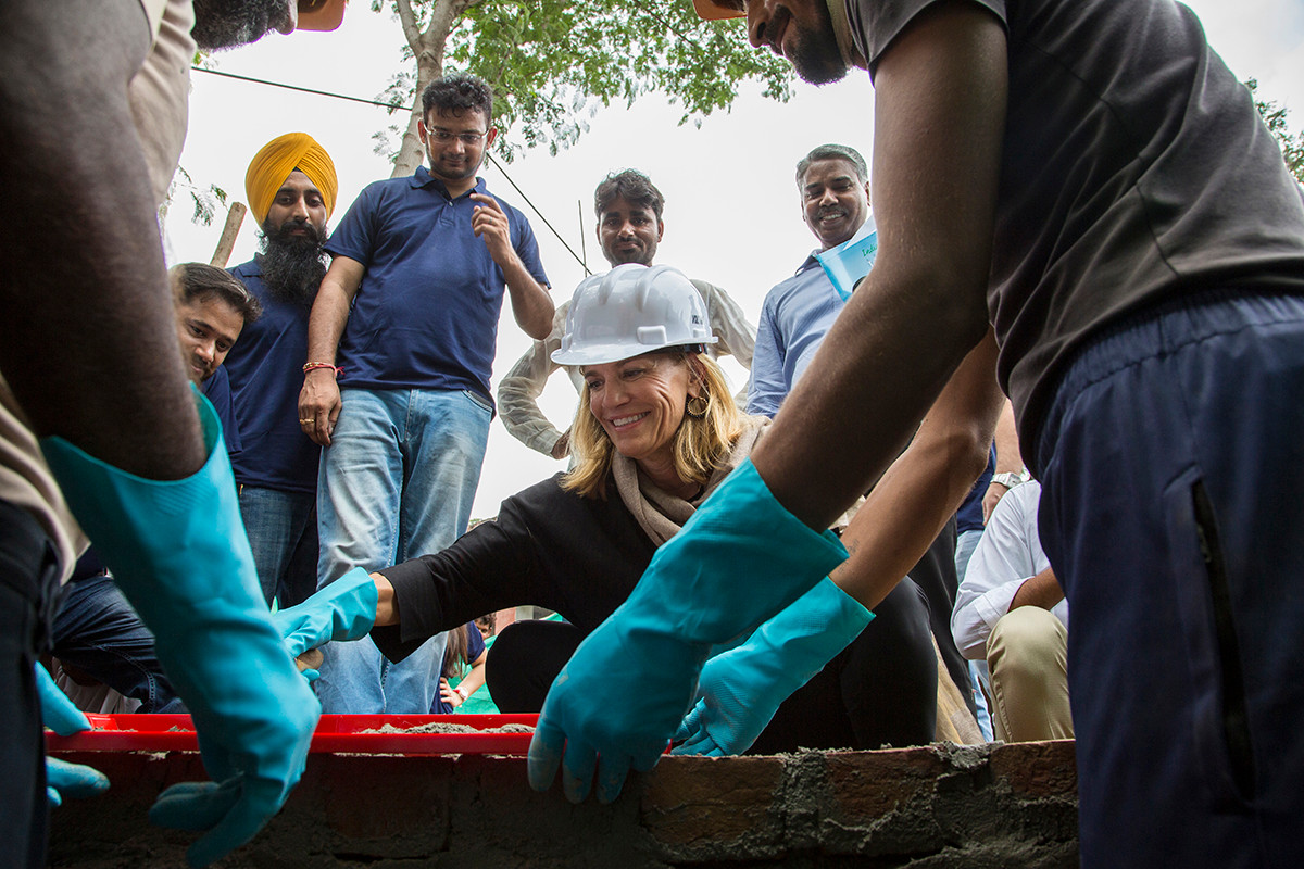 Laura Kohler lays bricks for a new toilet block at the Government Middle School at Khori village in Alwar district, Rajasthan, India for Kohler Stewardship's School Sanitation Project, 2018.