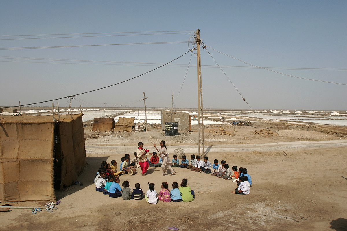 Anjar, Gujarat, 2005: Children of migrant salt-pan workers play a learning game at a site school supported by AIF.