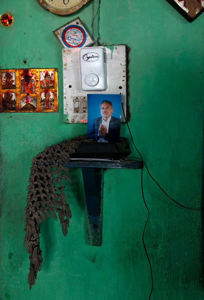 Portrait of Pritilal Thakre, a farmer from Dongrala village who committed suicide, in his home.