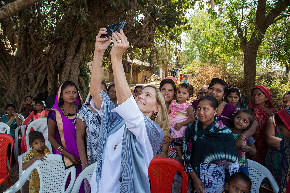 Laura Kohler with community members during Kohler Stewardship program at Randedi village near Kohler's plants in Jhagadia, Gujarat, India, 2019.