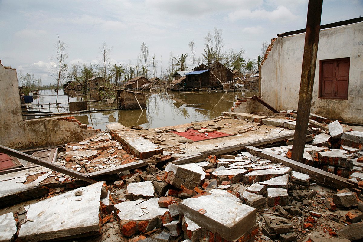 View of a devastated village through the ruins of a school building destroyed by Cyclone Nargis in a village near Kaw Hmu, in the Yangon Division of Myanmar (Burma).