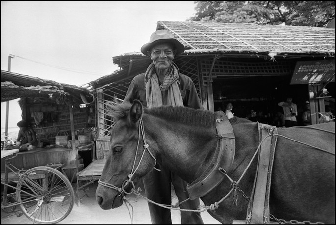 A man with his horse cart.