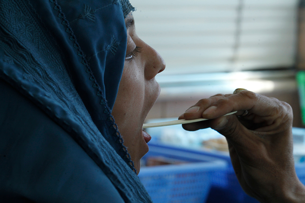 A beneficiary at a mobile clinic in Afghanistan. Photograph by Mustafa Quraishi