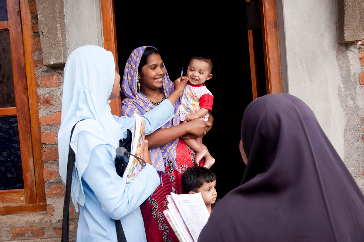 FPA volunteers, Rizana and Irfana, attached to the government health program, during a home visit to the home of Nazeema in the Kathankudy locality of Batticaloa, Sri Lanka, 2012.