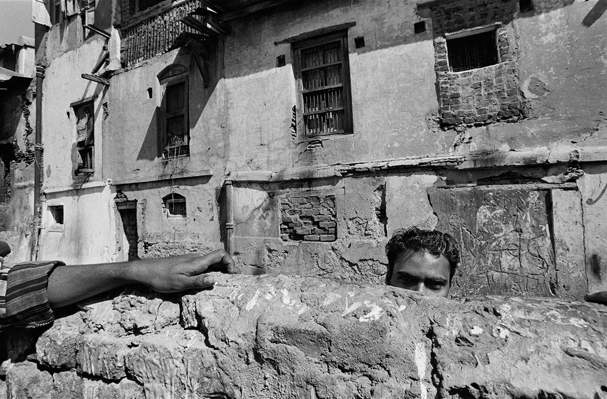 A Muslim youth at the Wall in Jilaiwada.