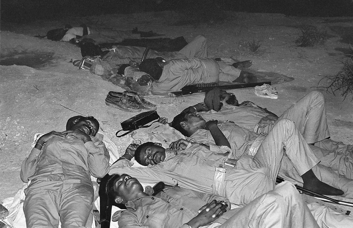 Gang members rest the night before their surrender outside Madanpura village, 1982.