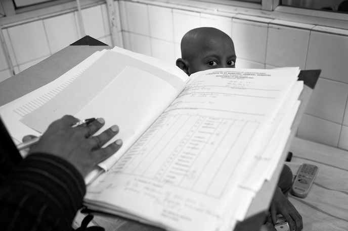 A doctor attends to a HIV+ child patient who is also suffering from blood cancer in the paediatric ward at the Lokmanya Tilak Municipal College & General Hospital at Sion in Mumbai, 2008. HIV+ children are admitted to the general paediatric wards to avoid stigma.