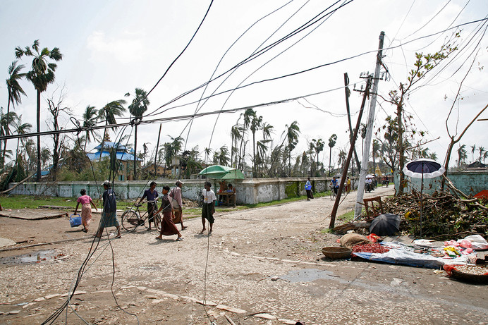 Damaged electrical wires hang over a street in Bogalay devastated by Cyclone Nargis, in the Irrawaddy Division of Myanmar (Burma).