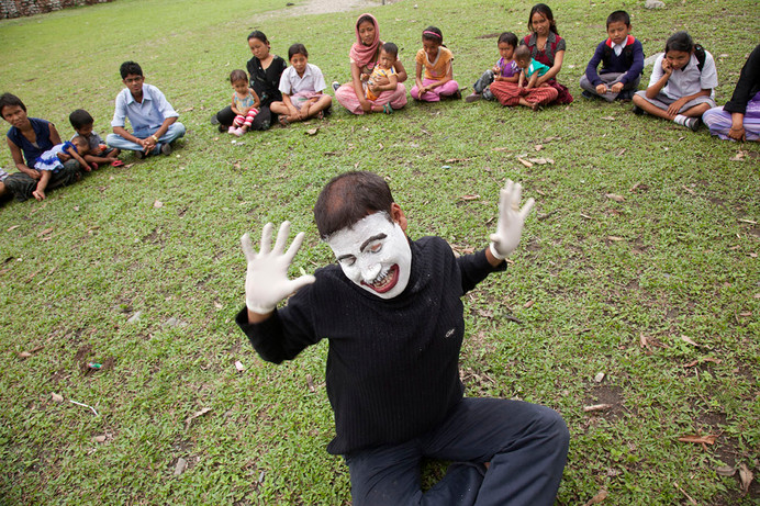 Staff member Govinda Ganguly does a pantomime show on the ill-effects of drug addiction during an immunization camp conducted by Family Planning Association of India's (FPAI) Kalchini branch at Buxa Fort, Kalchini, West Bengal, India, 2012.
