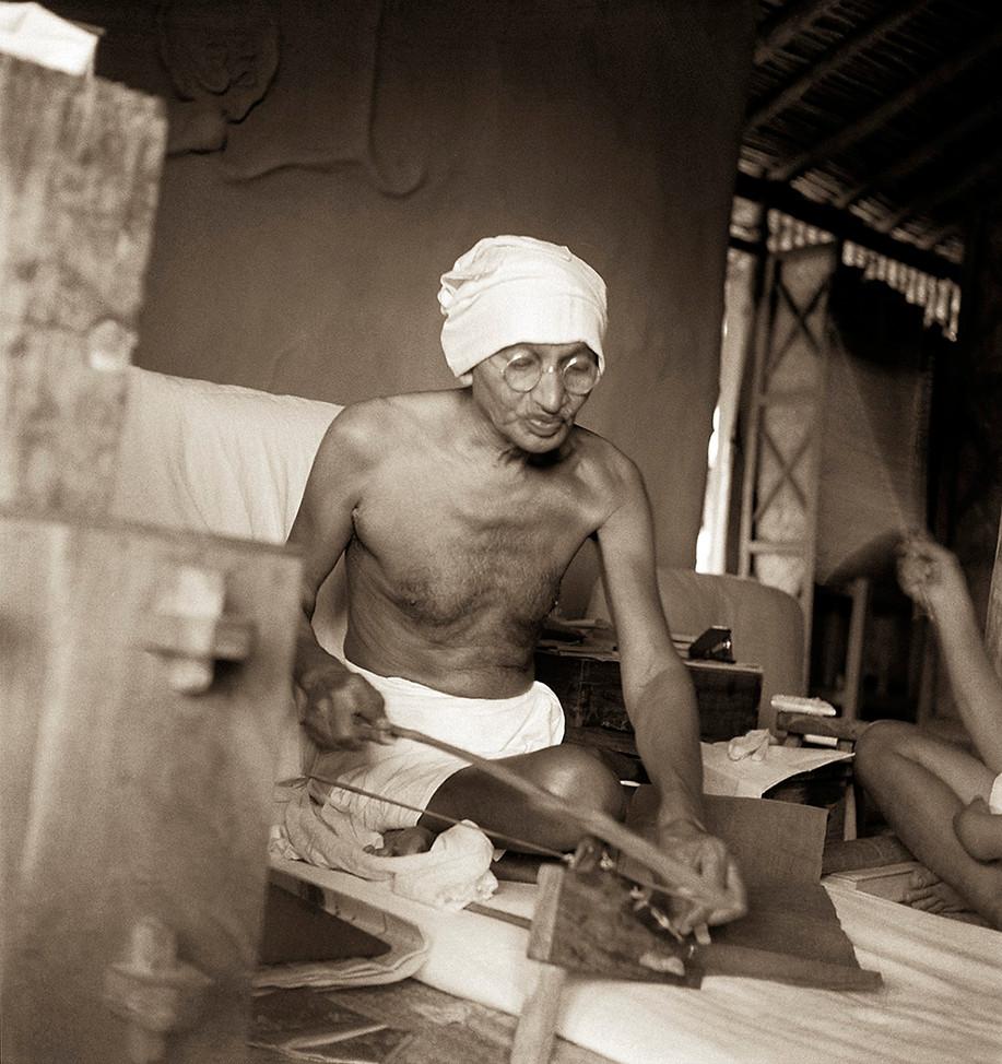 Sevagram Ashram, 1940: Mahatma Gandhi spinning on Dhanush Takli.