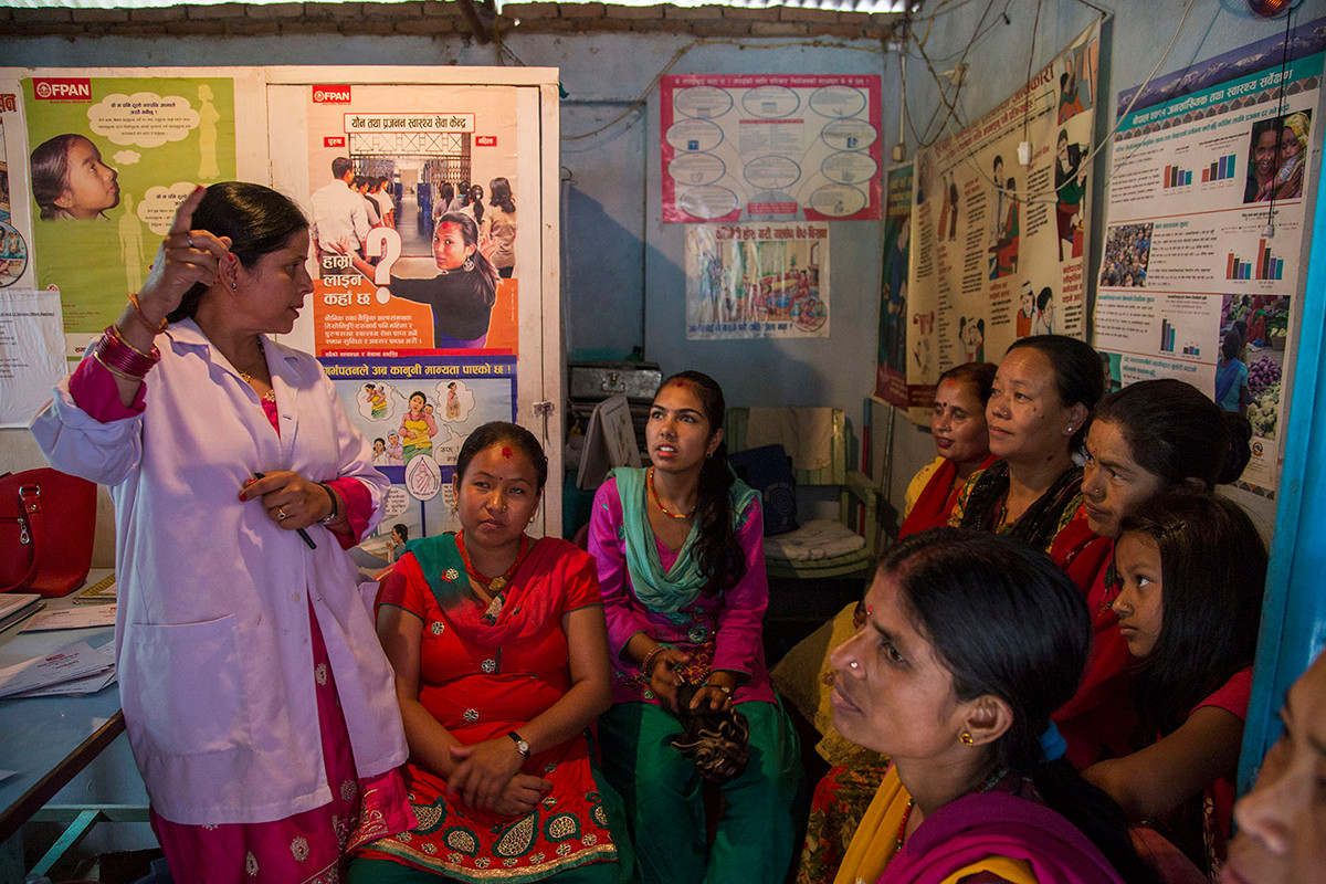Radha Uprety, Senior Community Medical Assistant, with beneficiaries at FPAN's Kapan Community Clinic, Kathmandu, Nepal, 2015.