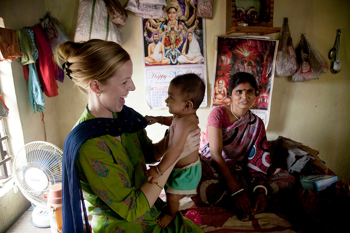 AIF Fellow Margy Elliot, working with Calcutta Kids, during a home visit to meet Ajay, a child recovering from malnutrition, and his aunt, Parmila Devi, at their home in Fakirbagan, Salkia, Howrah, West Bengal, 2012.